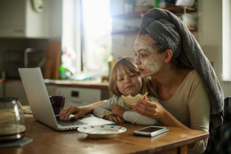Mum with daughter having breakfast