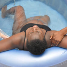 Woman in labour birthing pool