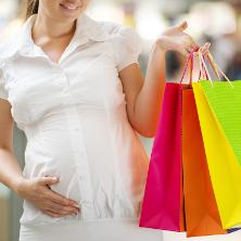 Pregnant woman shopping maternity wear