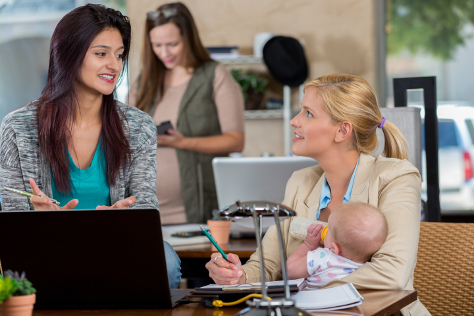 Mother in office with baby