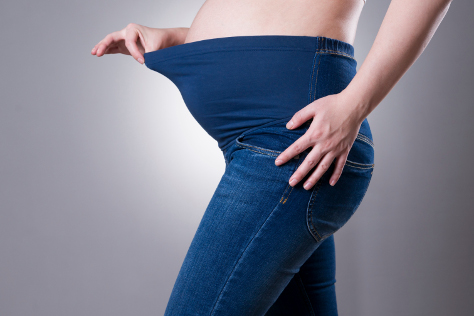 Woman with perfect maternity jeans
