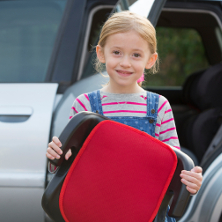 Child holding booster car seat