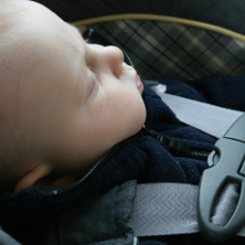 Baby strapped in car seat