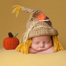 Newborn baby in Halloween costume