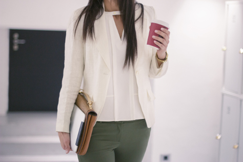 Woman walking into office with coffee