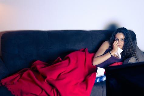 Woman crying watching TV
