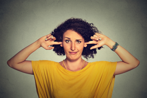 Woman with her fingers in her ears