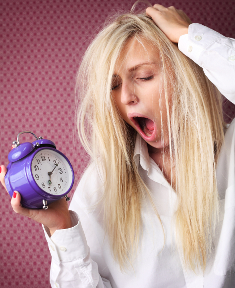 Mum holding clock yawning