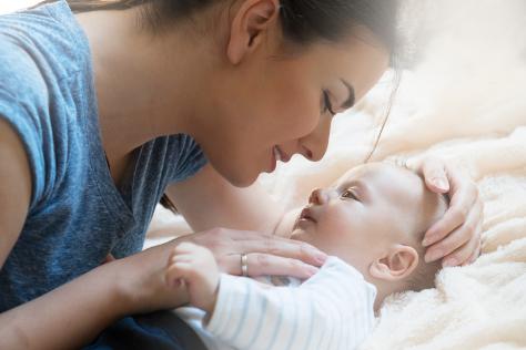 Mum bonding with baby