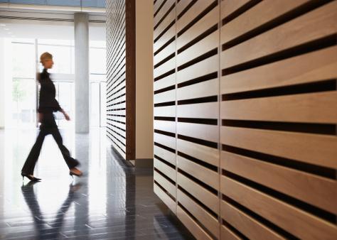 Mum walking through office