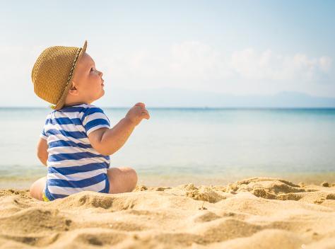 baby on the beach in the sun