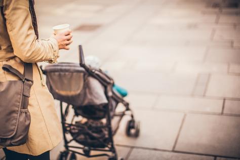 Mum pushing stroller